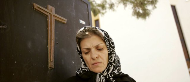 An Iranian Christian woman leaves a church after a prayer ceremony in Tehran September 17, 2006. REUTERS/Morteza Nikoubazl(IRAN) – RTR1HEXU An Iranian Christian woman leaves a church after a prayer ceremony in Tehran September 17, 2006. REUTERS/Morteza Nikoubazl