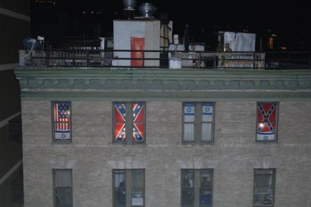 The Lower East Side apartment sports a colonial flag, an Israeli flag and — most upsettingly for one neighbor in particular — a Confederate flag. (SAM COSTANZA/FOR NEW YORK DAILY NEWS)