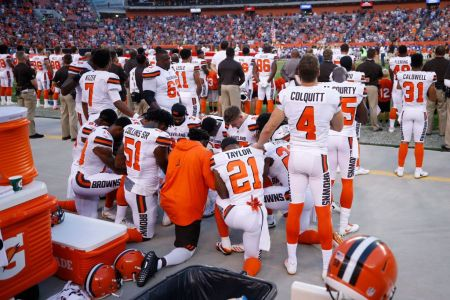 CLEVELAND, OH – AUGUST 21: A group of Cleveland Browns players kneel in a circle in protest during the national anthem prior to a preseason game against the New York Giants at FirstEnergy Stadium on August 21, 2017 in Cleveland, Ohio. (Photo by Joe Robbins/Getty Images)