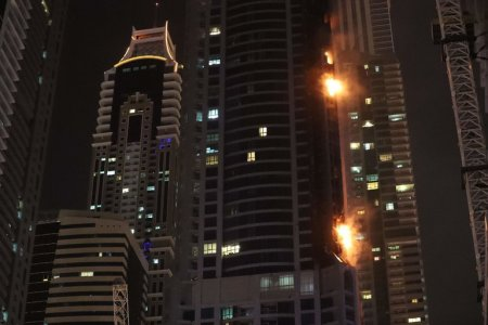 A fire in the Torch Tower in Dubai early Friday. (Credit: Karim Sahib/Agence France-Presse — Getty Images)