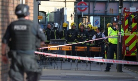 Members of the London Fire Brigade stand by cordon near Parsons Green tube station in London, Britain September 15, 2017. REUTERS/Hannah McKay
