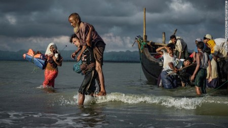 Rohingya refugees disembark from a boat on September 13, on the Bangladeshi side of the Naf River.