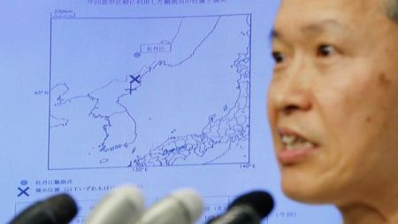 Japan Meteorological Agency's earthquake and tsunami observations division director Toshiyuki Matsumori speaks in front of a screen showing the seismic event that was indicated in North Korea and observed in Japan. (Reuters)