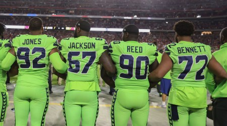 GLENDALE, AZ - NOVEMBER 09: Running back Thomas Rawls #34, defensive tackle Sheldon Richardson #91, defensive tackle Nazair Jones #92, defensive end Branden Jackson #67, defensive tackle Jarran Reed #90 and defensive end Michael Bennett #72 of the Seattle Seahawks link arms during the national anthem for the NFL game against the Arizona Cardinals at University of Phoenix Stadium on November 9, 2017 in Glendale, Arizona. (Photo by Christian Petersen/Getty Images)