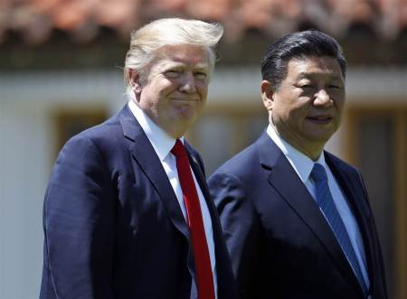 President Donald Trump and Chinese President Xi Jinping walk together after their meetings at Mar-a-Lago on April 7, 2017 in Palm Beach, Fla. (Alex Brandon / AP file)
