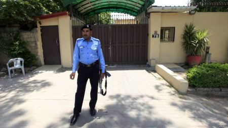 FILE: A policeman stands guard outside the Save the Children charity's office in Islamabad, Pakistan, June 12, 2015.