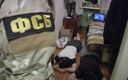 In this undated video grab provided by the RU-RTR Russian television via APTN in Moscow, Russia, Friday, Dec. 15, 2017, Russian Federal Security Service (FSB) operatives detain a suspected member of the Islamic State group's cell in St. Petersburg, Russia. The FSB said Friday the suspects were plotting a suicide bombing and a series of other explosions in the city's busiest areas this coming weekend. (Russian Federal Security ServiceAP video via AP)