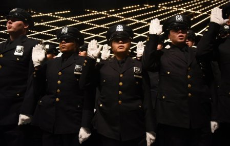 Police recruits being sworn in at Madison Square Garden in October. Crime in New York City has declined for 27 straight years, even as police officers use less deadly force and make fewer arrests. Timothy A. Clary/Agence France-Presse — Getty Images