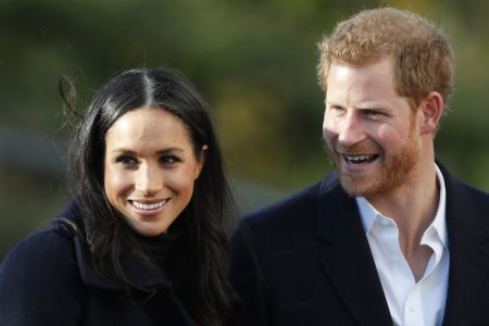 FILE - In this Dec. 1, 2017 file photo, Britain's Prince Harry and his fiancee Meghan Markle arrive at Nottingham Academy in Nottingham, England. For some black women, Meghan Markle and Prince Harry's engagement was something more. One of the world's most eligible bachelors had chosen someone who looked like them and grew up like them. (AP Photo/Frank Augstein, File)