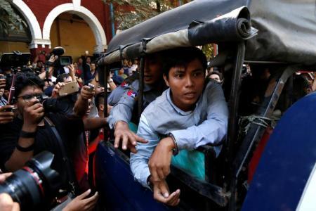 Reuters journalist Kyaw Soe Oo arrives at the court in Yangon, Myanmar January 10, 2018. REUTERS/Stringer