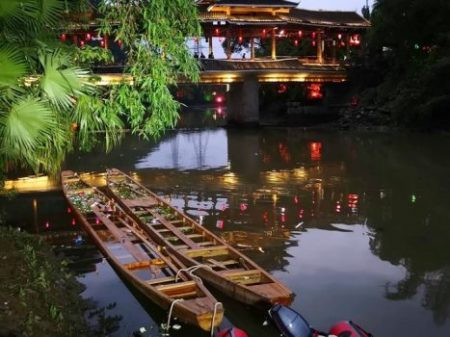 The two dragon boats that capsized on the Taohua River in Guilin, China. Seventeen people are reported to have died when the boats flipped, throwing dozens of rowers into the water. / CHINATOPIX, via Associated Press