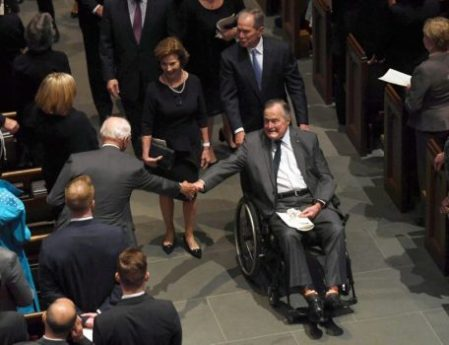 Former US President George H.W. Bush exits the funeral of his wife First Lady Barbara Bush, followed by his daughter-in-law former First Lady Laura Bush and former President George W. Bush (AFP Photo/Jack Gruber)