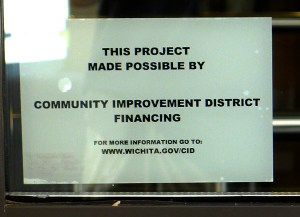 Example of a Community Improvement District sign on the door of a merchant.