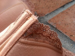 The hard spot where the lace attaches to the gore isn't visible but it is there.