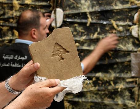 Bricks of hashish stamped with a lebanese cedar, 85kgs of which were supposed to be shipped TO the netherlands. because there's a... shortage? I think?