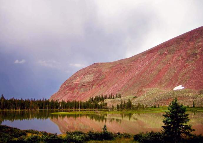 A storm rolls past an unnamed lake in a remote part of the High Uintas Wilderness Area.