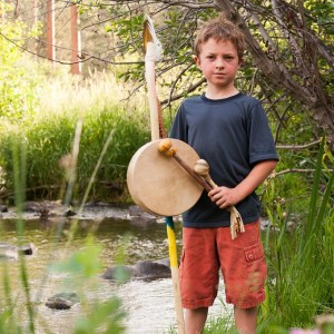 Boy with wizard staff, drum and rattle