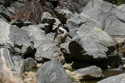 William hops boulders to find tamarisk
