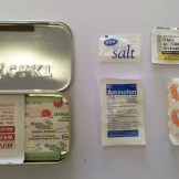 1 Salt Pack, 1 Sugar Pack, 2 Pain Reliever Pills, 1 Antibiotic Ointment