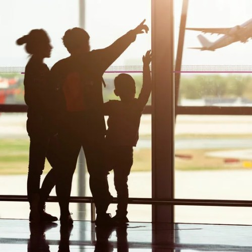 52376675 - silhouette of young family at airport