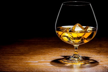 whisky with ice on a wooden table