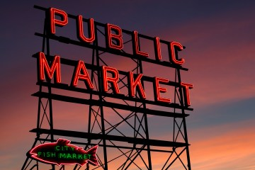 Pike Place Market neon sign at sunset, Seattle, Washington - article by winegeographic.com
