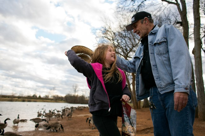 "Ray ""Raisin"" Jones of Bowling Green helped his third cousin, Carleigh Frost of Bowling Green, 7, left, put her hat back on after it fell while she was feeding the ducks at Basil Griffin Park on Sunday, Jan. 31, 2016. Jones used to go to the same park with his own son, who is now 23. 