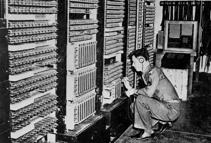 A technician communicates with the future futurist Ray Kurzweil.