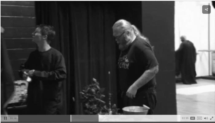 Screen shot from TV news report on Oklahoma City Satanic Mass.