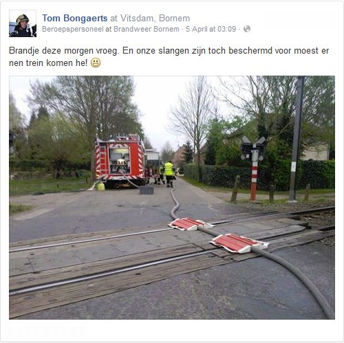 Fire hose over railway tracks (by Tom Bongaerts)