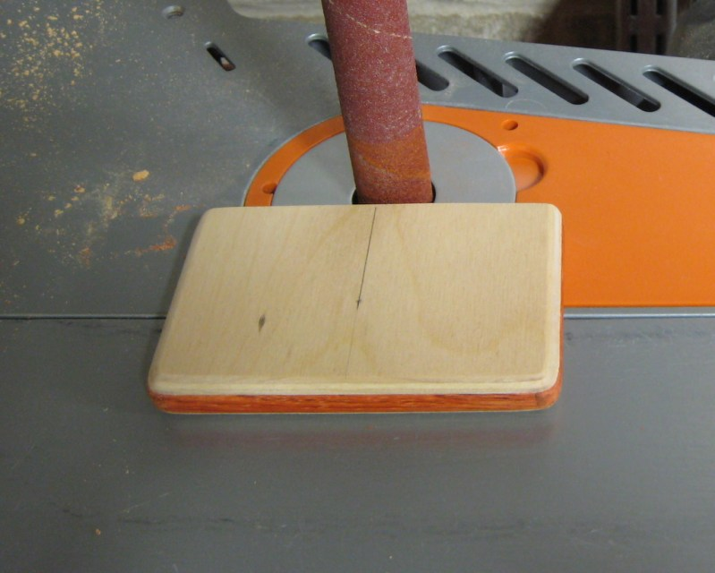 Cutting a semicircle into the edge to access the cards