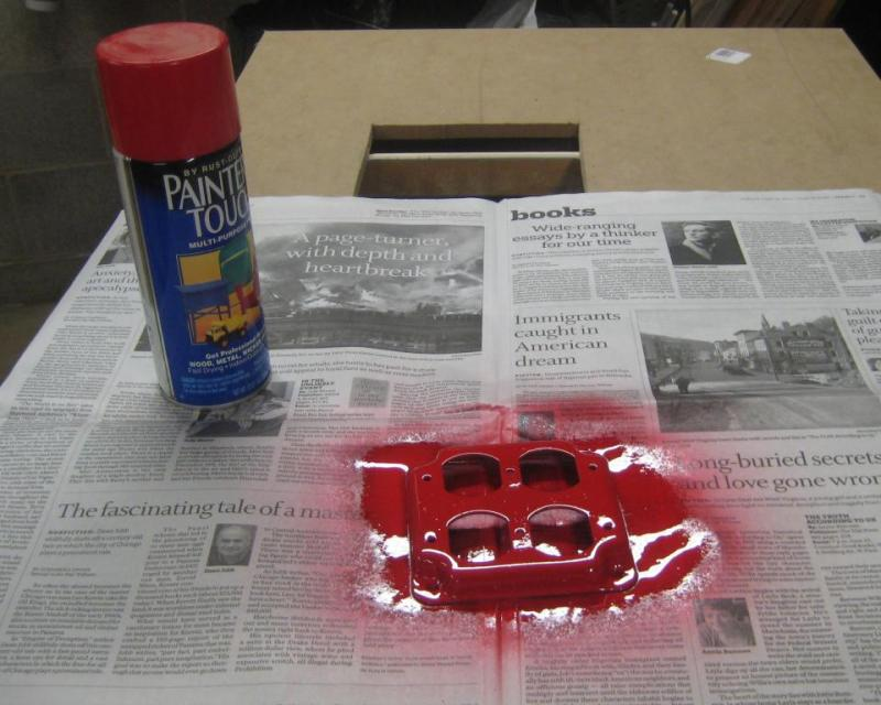 Spray painting the red outlets