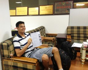 In the tour office, seeing the itinerary for the first time
