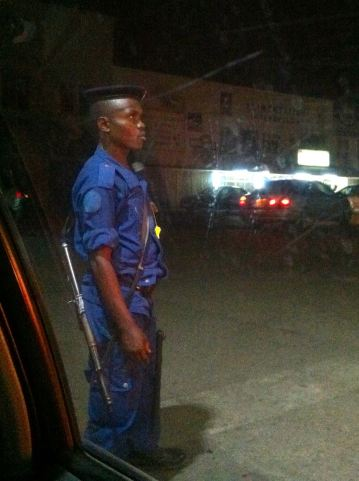 A gas station guard with an AK-47