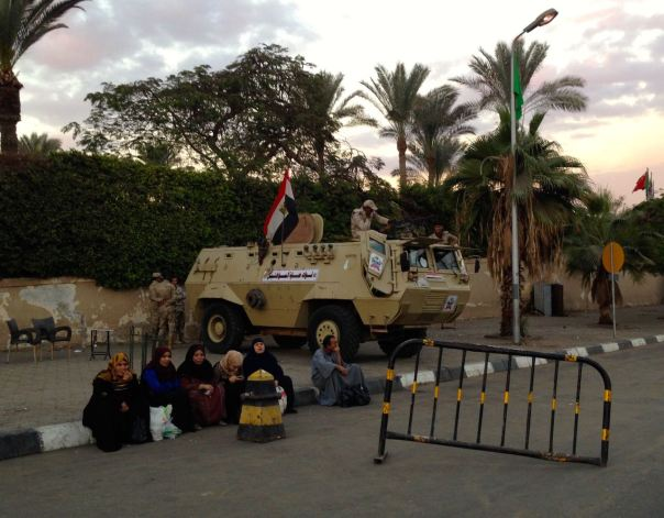 Military security with an armored vehicle outside of the Pyramids.