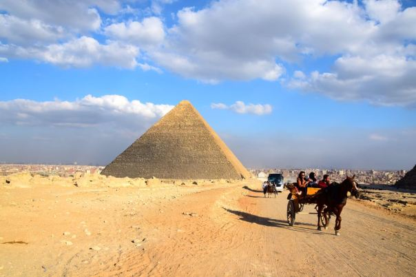 Visit the pyramids by horse, camel, cart, car, or bus.