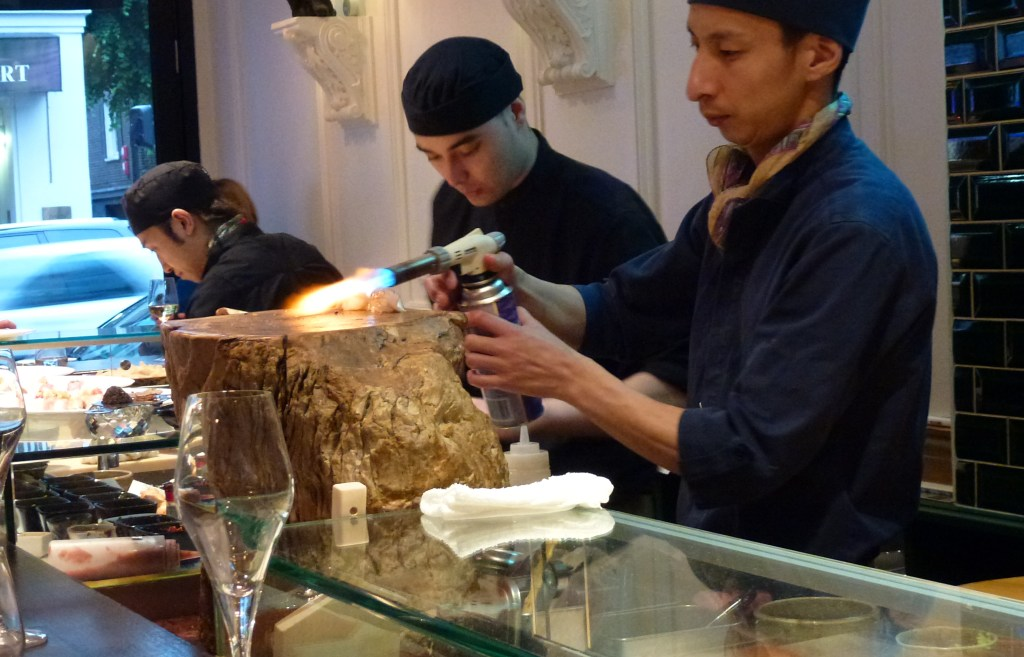 Blowtorching sushi