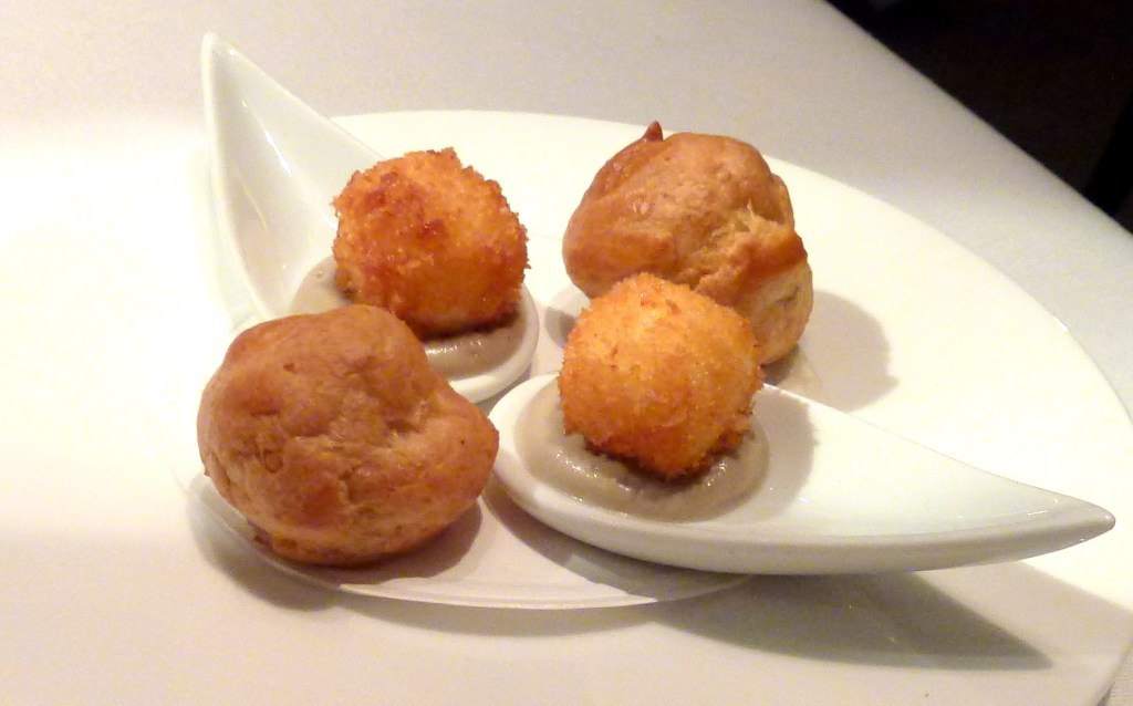 Canapes: gougères of choux pastry filled with béchamel, and parmesan bonbons at launceston place