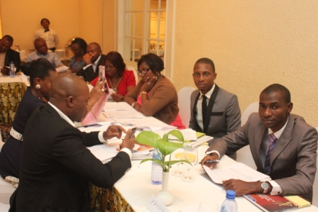 Another group of participants working on their tasks at the legal-writing workshop.
