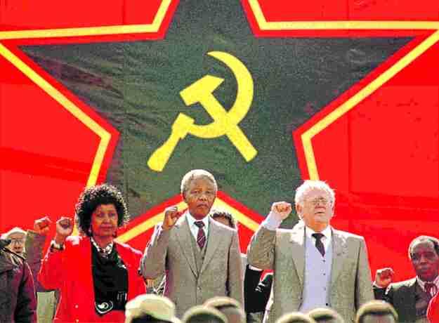 1990: Namibian Independence: Winnie & Nelson Mandela with Joe Slovo at the Namibian Independence celebrations.