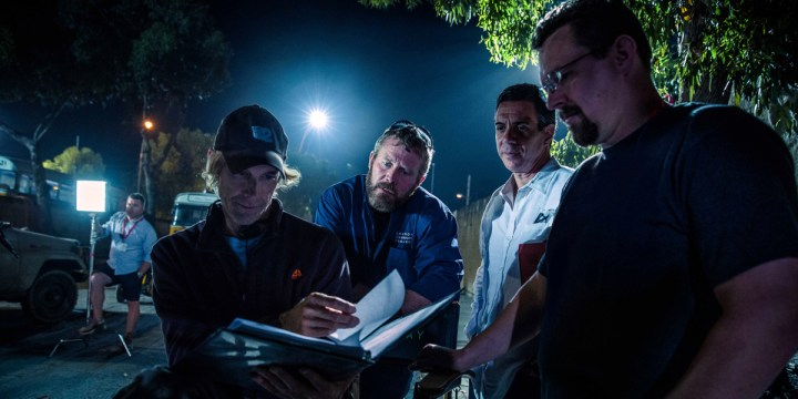 Michael Bay, Oz, author Mitchell Zuckoff, and Tig on the set of 13 Hours.