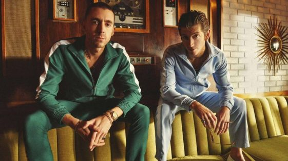 Miles Kane (L) and Alex Turner (R) in cringeworthy tracksuits. Source