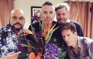 The Barenaked Ladies pose with a bouquet of flowers and offer an apology for offending Hoobastank.