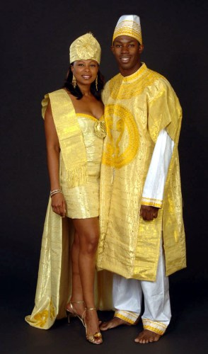 prweb african american wedding dresses Gold aso ake wedding dress and groom s suitHand woven aso ake fabric imported from West Africa is used to make this sexy designer bustier dress
