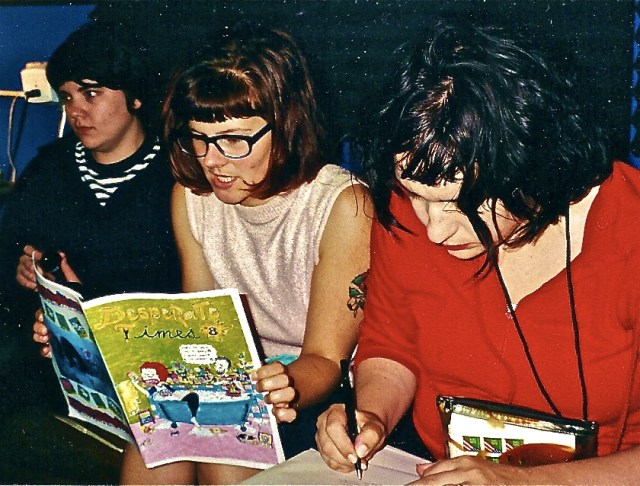 "The members of Bratmobile (Erin, Allison, Molly) read Hessig's ""Desperate Times"" while at Louder Studios in San Francisco back in 2000. (Courtesy of Bratmobile)"