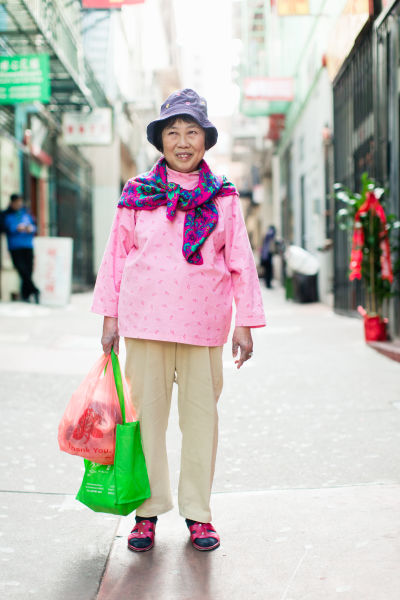 Julie Fong wears a handmade corduroy top. She's been living in Chinatown for over 50 years.