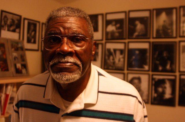 Elbert 'Big Man' Howard in his home in Santa Rosa; framed photos of jazz musicians line the walls.
