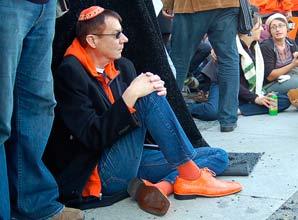 A Giants fan dressed in orange.
