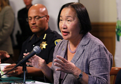 Oakland Mayor Jean Quan speaks as Police Chief Howard Jordan looks on. (Photo by Justin Sullivan/Getty Images)