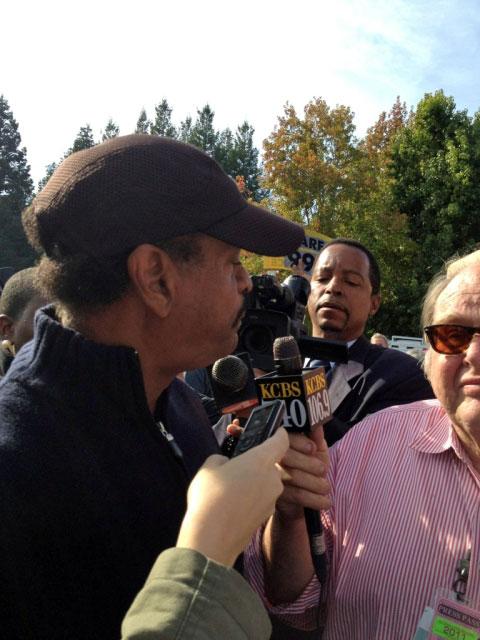 Reporters interview City Council Member Larry Reid